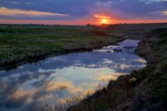 Sunset over Nosehill Creek (John Andersen (JPAndersen images)) Tags: sunset sky reflection clouds alberta yyc balzac nosehillcreek