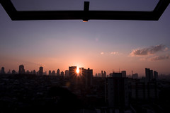 Before closing the window (Marcos Jerlich) Tags: light sunset brazil sky sun sunlight holiday window silhouette canon buildings star colorful july naturallight cielo depht saopaulocity canon700d canont5i marcosjerlich