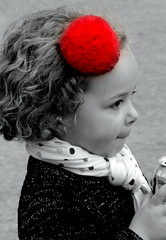 Red poofball - Portrait (patrick_milan) Tags: street red people blackandwhite bw white black girl monochrome children rouge noir child noiretblanc nb rue fille blanc personne petite streetview gens pompon poofball