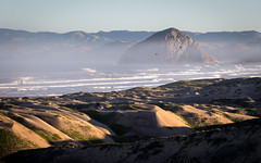 Morro Morning (Kevin Dinkel) Tags: ocean california morning travel blue sea brown mist seascape green water birds rock sunrise landscape photography bay early haze sand colorful kevin waves shadows escape dunes tide central places hills formation plug volcanic epic morro dinkel