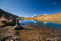 Chandratal, Himachal Pradesh (Bharat Baswani) Tags: moon lake snow mountains reflection stones valley ripples range himachal himalayas spiti pradesh glacial chandratal chandrabhaga