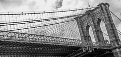 Brooklyn Bridge cables on cloudy day (Mikeinwayne...On and off...) Tags: road nyc newyorkcity bridge bw usa metal stone architecture blackwhite cloudy geometry angles arches cables brooklynbridge