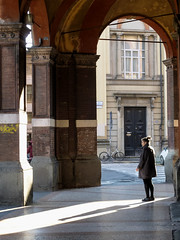 Via Zamboni (lorenzog.) Tags: people italy sunlight lumix streetphotography smoking panasonic bologna sunbeam emiliaromagna 2016 viazamboni