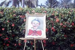 Clown Painting, 1968 (Alan Mays) Tags: ephemera slides transparencies photographs photos foundphotos kodachrome ethel women artists painters clowns clownpaintings paintings oilpaintings easels frames yards december 1968 1960s old vintage