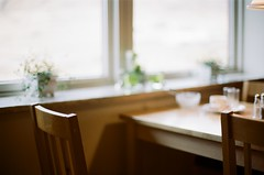 A seat at the table (samtakes) Tags: film window table islands chair nikon solitude bokeh seat f100 400 lonely impressions portra impression guesthouse faroe sof faroes filmisnotdead gjogv