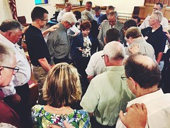 Praying over the Executive director of the CRC