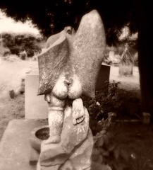 bum's the word (HoosierSands) Tags: london grave surrey cherub churchyard damaged petersham