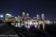 Boston for Women (IdeaLuz Photography) Tags: city pink sea sky usa building water boston skyline architecture night skyscraper star boat long exposure downtown cityscape breast shot angle outdoor district massachusetts sony wide cancer front boardwalk financial ultra starburst waterscape harbord 14mm a7ii rokinon