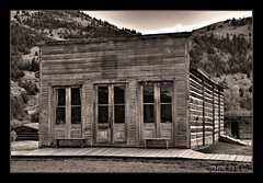 Bannack MT 1 bw (the Gallopping Geezer '5.0' million + views....) Tags: statepark building history abandoned canon montana mt decay roadtrip structure historic mining faded worn western restored ghosttown weathered preserved 2008 wildwest decayed geezer outlaw corel oldwest bannack henryplummer