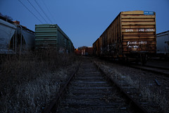 Graffiti Yard (twinsfan7777) Tags: city sunset cars love grass minnesota yellow night yard train canon dark graffiti photo long exposure paint track dusk horizon tracks minneapolis trains traveling shipping containers canoneosrebel550d canon1855mmf3556isstm