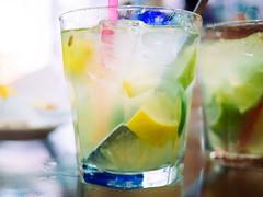 caipirinha (miemo) Tags: madrid travel ice glass closeup bar spring spain bokeh olympus drinks nightlife caipirinha omd panasonic20mmf17 em5mkii