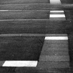 fresh paving (Andrew Malbon) Tags: leica leicam9 rangefinder blackwhite bw strongisland street streetphotography stripes summicron 90mmf2 promenade solent hampshire south southcoast portsmouth southsea