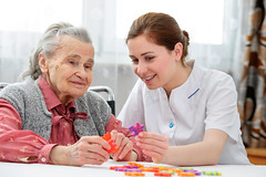 Elder care nurse playing jigsaw puzzle with senior woman in nursing home (VIP Care Solutions Ltd.) Tags: old two people game home senior smiling work women uniform play wheelchair social hospice patient medical puzzle together elderly age service rest oldwoman worker leisure nurse jigsaw extended care 80 gratitude nursing geriatric assistance disease retirement helping handicapped retirementhome rehab illness dementia jigsawpuzzle caretaker nursinghome demented eldercare rehabilitation occupation elderlypeople pensioner twowomen elderlywoman workingfromhome workfromhome workathome assisted impairment agedcare socialworker caregiver workingwoman homecare carehome seniorcare helpingpeople nurseandpatient nursinghomecare
