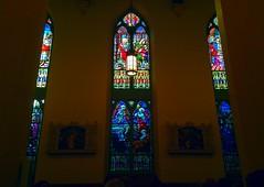 Beautiful Light (newenglandgal) Tags: blue light red church catholic stainedglass iphone