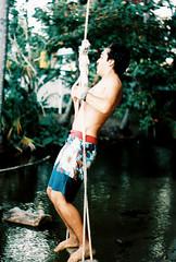 (SofaHiggins) Tags: ocean boy tree guy beach puerto kid outdoor swing palm rico suit teen tropical caribbean bathing hang teenage