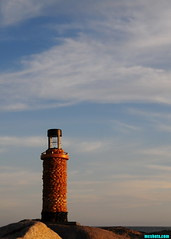 JettyLighthouseAtSunset (mcshots) Tags: ocean california sunset sea sky usa lighthouse water clouds lights evening coast solar rocks lighthouses stones jetty stock pebbles bamboo socal handcrafted mcshots beacon losangelescounty functionalart stonelighthouses beachpebblelighthouse gardenlighthouses solarlighthouses