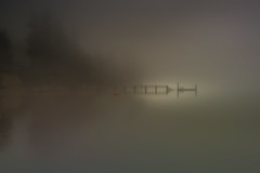 Early Discovery (jeanmarie shelton) Tags: ocean morning light sea sky sunlight mist nature water fog architecture sunrise reflections dark landscape outdoors dock nikon serene minimalism waterscape jeanmarie jeanmarieshelton