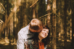 Forest kissing (Yuliya Bahr) Tags: portrait sun love nature girl smile yellow forest happy engagement spring kiss together lovestory tender hochzeitsfotografberlin weddingphotographergermany hochzeitsfotografmnchen hochzeitsfotografbrandenburg hochzeitsfotografpotsdam hochzeitsfotograftirol