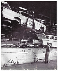 Body Meets Chassis, Vauxhall 1960. (ManOfYorkshire) Tags: bw plant history monochrome hall moving factory technology body engine line nostalgia final mating production worker chassis conveyor luton dunstable meets vauxhall assembly advanced 1960 overall hoist cresta boilersuit operative
