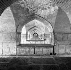 Arches under the Khaju Bridge (miloniro) Tags: blackandwhite 120 mamiya film monochrome analog mediumformat 50mm iran kodak tmax 400 mamiya6 esfahan isfahan