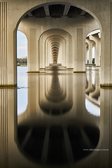Symmetry (Valley Imagery) Tags: bridge symmetry jacksonville road reflection usa florida
