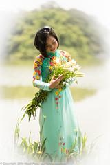 Hanoi Flower Girl (Pexpix) Tags: female flowers girl hanoi lady model nikkoraf85mmf14d nikondf vietnam water woman hni
