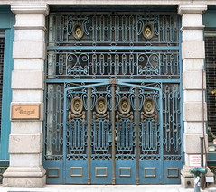 Gated doorway, East 11th Street, Greenwich Village, New York (Spencer Means) Tags: gate iron metalwork painted bijanroyal antiques antique dealer east 11th eleventh street greenwichvillage new york city manhattan nyc ny blue turquoise gold dwwg wow