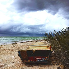 I of the storm (Mister Blur) Tags: boat beach sand sea storm clouds barca playa chicxulub yucatn mxico tormenta iphone se iphoneography