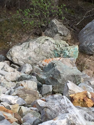 The copper mineral malachite gives rock a green sheen.
