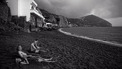 may be it will rain (j.p.yef) Tags: travel people bw italy beach water monochrome clouds dark blacksand sw ischia badweather darksky fango yef peterfey jpyef