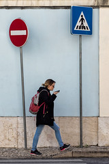 'Betwixt and Between' (Canadapt) Tags: woman signs portugal wall lisbon pedestrian signpost crosswalk alfama donotenter midstep canadapt