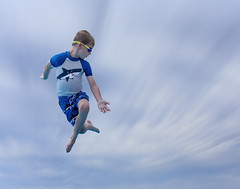First jump. (dshoning) Tags: jump leap 52weeksof2016 pool board sky goggles boy swimming clouds