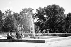 Minolta Hi-Matic G - Couple at the Fountain (Kojotisko) Tags: bw streetphotography brno creativecommons czechrepublic streetphoto vx400 konicamonochromevx400 minoltahimaticg konicamonochrome