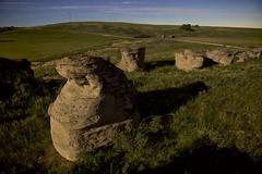 Hoodoo on the prairie (John Andersen (JPAndersen images)) Tags: sky outcrop grass rock night creek river sandstone alberta hoodoo prairie geology