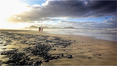 Black stones (Barbara Zemann) Tags: stone cloud clouds lanzarote mist wind sea water sand landscape beach