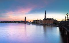 Magenta Stockholm Morning (redfurwolf) Tags: bridge sea sky sunrise sweden stockholm cityhall magenta sthlm stadshuset cityview riddarholmen sonyalpha sel35f14z redfurwolf