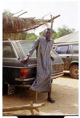 Portrait Man Senegal , Africa. (bo foto) Tags: africa portrait man mercedes nikon taxi scan senegal analogue casamance polio woodenleg nikonfm abene boudewijnolthof dimagescanelite5400