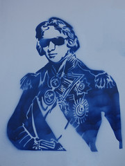 Nelson is Cool (Steve Taylor (Photography)) Tags: blue newzealand streetart man art fun cool stencil nelson monotone nz southisland medals sunnies monocolor monocolour sunglassies