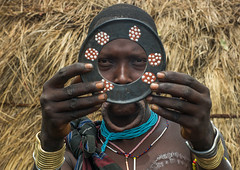 A mursi tribeswoman holding a traditional lip-plate, Omo valley, Mago park, Ethiopia (Eric Lafforgue) Tags: africa portrait people woman color horizontal outdoors nationalpark women pattern african decorative traditional culture plate tribal hut ornaments clay blackpeople omovalley extended tradition ethiopia tribe disc bodyart mago mursi enlarged oneperson indigenous decorated adornment hornofafrica ethiopian eastafrica abyssinia expanded onepersononly blackskin adornments onewomanonly loweromovalley tribeswoman 1people indigenousculture lipplug lipplate magopark blackethnicity liphole onematureadultonly ethio162220