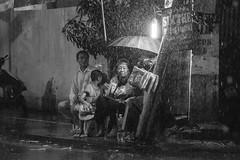 Family Business (Marc Molenaar) Tags: city night asia streetphotography vietnam nightlife hanoi oldquarter rainshowers
