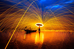Showers of hot glowing sparks (Krunja) Tags: light red orange abstract motion hot color art texture wool nature beautiful yellow metal night danger circle thailand outdoors shower fire flying dangerous energy pattern bright image fireworks slag vibrant background steel spin hell trail flame torch burn sling round heat glowing swirl blaze sparks flaming th fiery bouncing changwatchonburi tambonbangphra