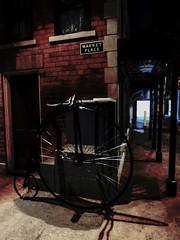 The Black Penny (Steve Taylor (Photography)) Tags: blue shadow newzealand christchurch brown black building brick art bike metal museum architecture digital concrete canterbury cycle nz southisland marketplace pennyfarthing