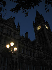 (Kelvin P. Coleman) Tags: city light sky urban building tree tower clock lamp leaves silhouette architecture canon manchester evening town hall streetlight branch post outdoor dusk powershot frame bluehour gloaming