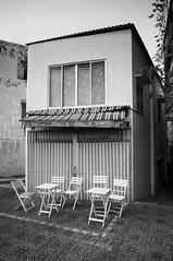 (kuuan) Tags: street bw architecture cafe chairs vietnam mf saigon manualfocus voigtländer hcmc heliar superwideheliar aspherical lotteryseller voigtländer15mm f4515mm voigtländerheliarf4515mm