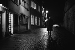 d. a. r. k. (Cem Bayir) Tags: street light shadow people blackandwhite bw monochrome rain night dark lowlight noiretblanc streetlights dramatic bynight rainy zrich cinematographer cinematic niederdorf zh