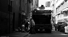 Where there's Muck there is Money (Neil. Moralee) Tags: street blackandwhite bw white canada black men monochrome trash truck work wagon mono garbage nikon zoom montreal candid working dirty cleaning clean collection dirt lorry gloves smell vehicle job 18300mm rubbis d710 neilmoralee canadaneilmoraleenikond7100