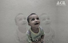 Baby Smiling (Akil Ashraful) Tags: baby smile smiling playing doll stylish akil ashraful akilashraful cute cutie beautifull bangladesh bangladeshi