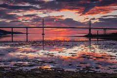 Firth Sunrise. (Gordie Broon.) Tags: kessockbridge inverness southkessock sunrise beaulyfirth morayfirth invernessfirth reflections seascape scotland schottland scottishhighlands ecosse escocia scozia szkocja alba caledonia highlandcapital seaweed paysagemarin seestuck scenario northeastscotland scenic view marina scenery paysage gordiebroonphotography highlanddawn northsea olympusomdem5 geotagged olympuszuiko1240mmlens