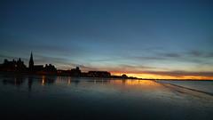 The two dog walkers (Lee Kindness) Tags: blue sunset sea orange scotland seaside bath edinburgh wideangle portobello zd714