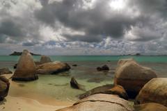 HoriZone (Robyn Hooz) Tags: sea verde green clouds indonesia rocks nuvole mare shore lowtide rocce bassa marea